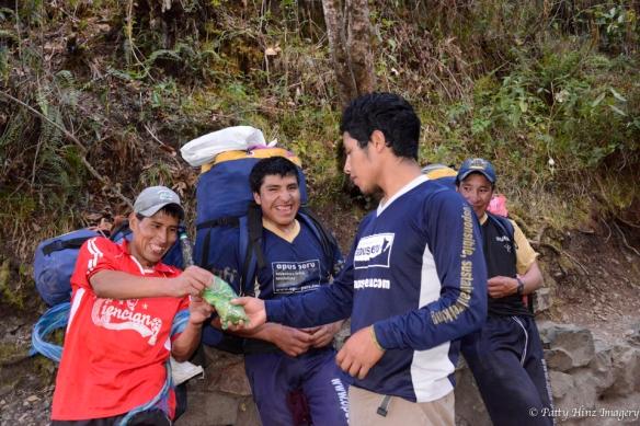Guide Arturo shares coca with porters. Photo courtesy of Patty Hinz.