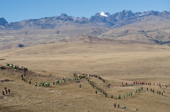 Dancing through the mountains during the pilgrimage.  Photographer: D. Mansell-Moulin