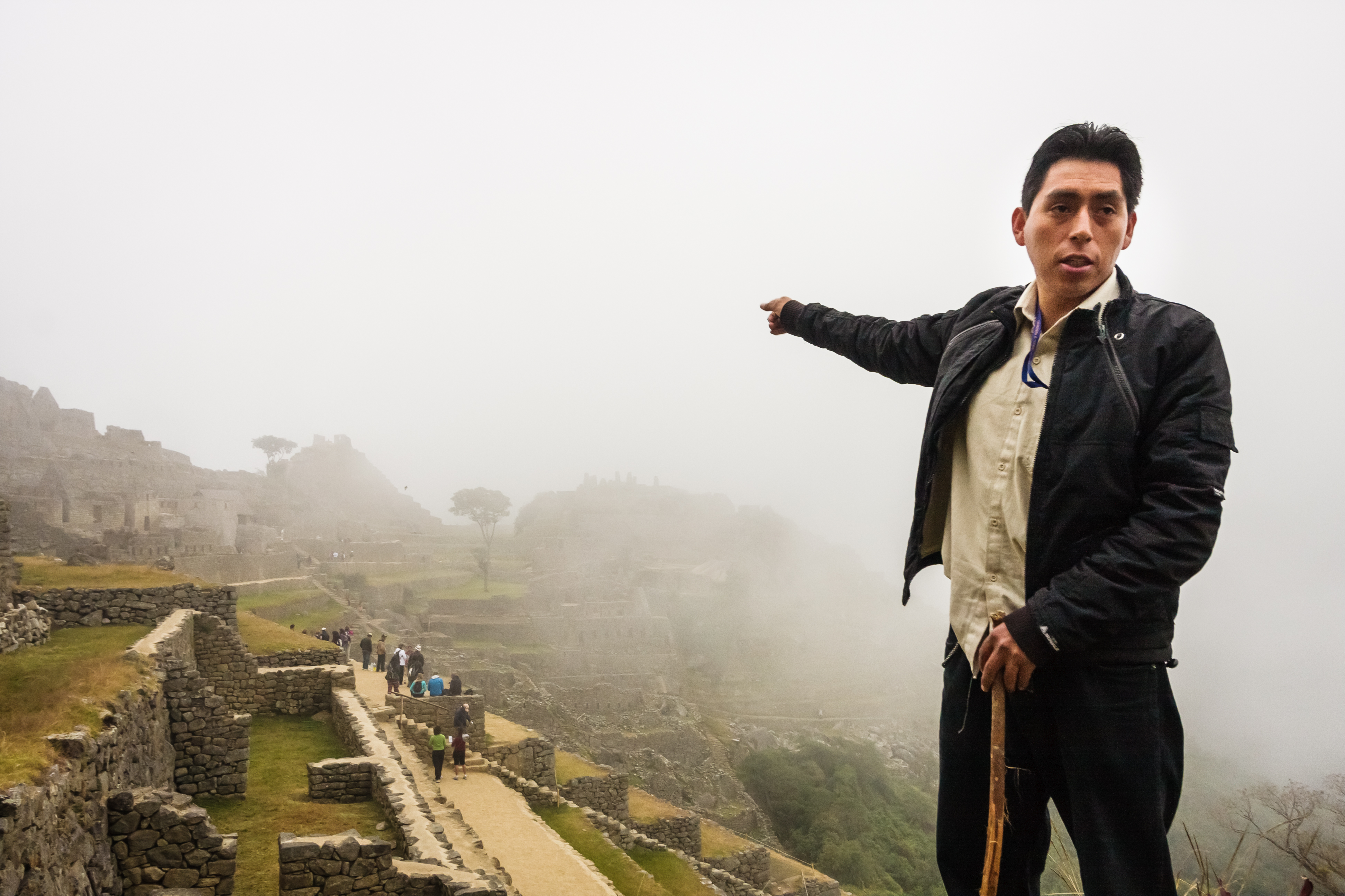 Having a guide at Machu Picchu helps add to your understanding of this mysterious site.  Here, Apus Peru guide Herbert Saldivar  helps point out the different landmarks in the fog. Photo by Isaiah Brookshire.