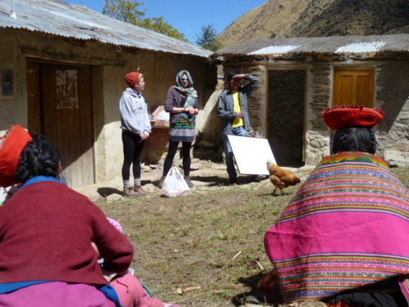A Mosqoy graduate working hand in hand with women of Rumira Sondormayo on a hygiene capacitacion in preparation for the arrival of international guests in August and September of this year.