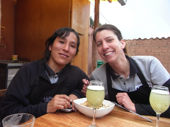 On the terrace with the plate and the pisco. Well done ladies!